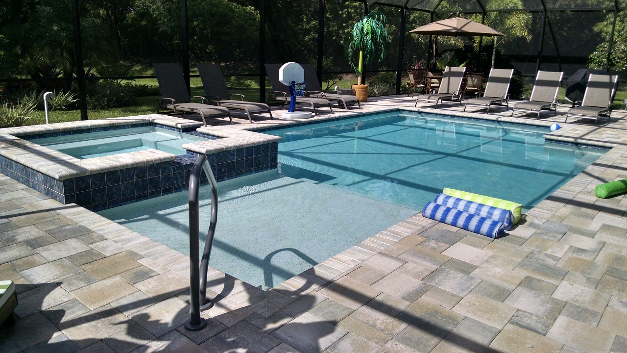 Geometric pool and spa design estero fl for Average square footage of a swimming pool